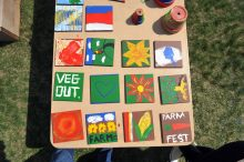 Colorful painted tiles on display at Wheaton's Farm Fest