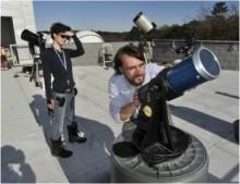 Tony Houser adjusts telescope