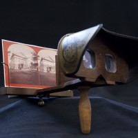Reproduction of a Stereoscope. Unidentified Artist. Wood, metal, paint. 1980s. Accompanied by Unidentified Photographers. Photograph, cardboard mount, paper backing. Both 9 x 18 cm. After 1850.