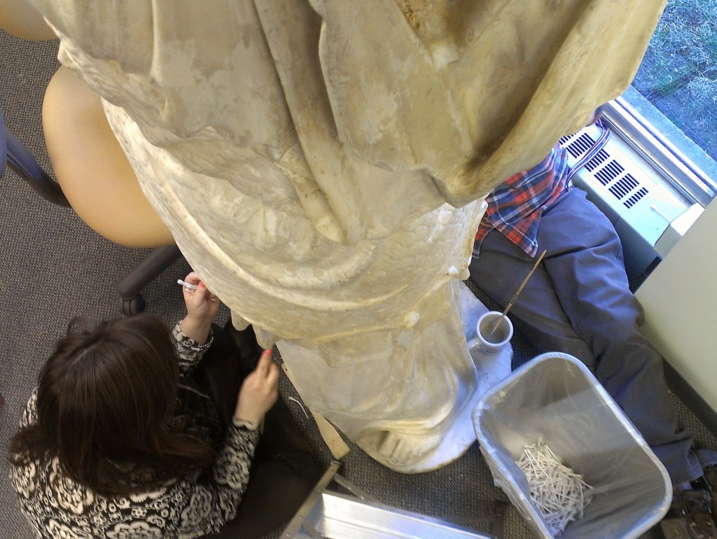 """Violet Knoll ('16) and Jack Brotherton ('17) working on """"Athena,"""" a plaster case in the Slide Library in the Watson Fine Arts Building"""