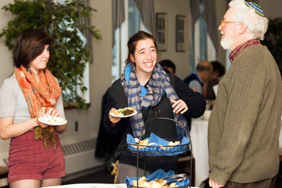 photo of student with faculty during a past Shabbat dinner