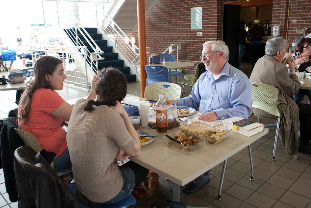 Professor Jonathan Brumberg-Kraus enjoys a meal with students at Hood Café