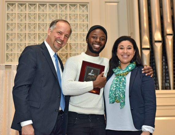 Michael Ivory '17 receives the MLK Legacy Award from President Hanno and Olivia Benissan '19.