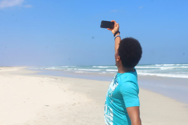 A person on a beach taking a selfie on himself on a beach