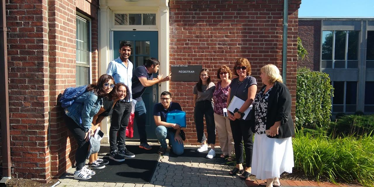 Some of our new international students posing with the Registrar's office