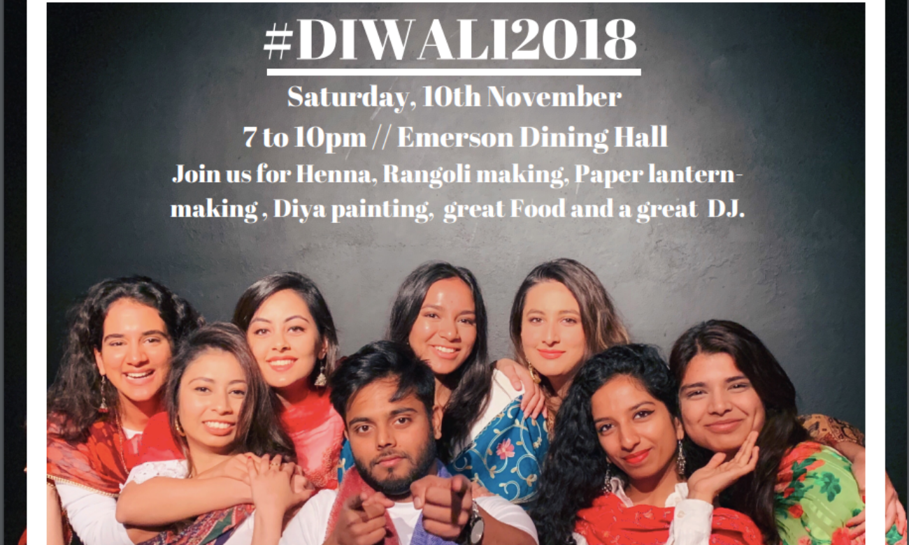 A group photo of students posing with the description of Diwali in the background