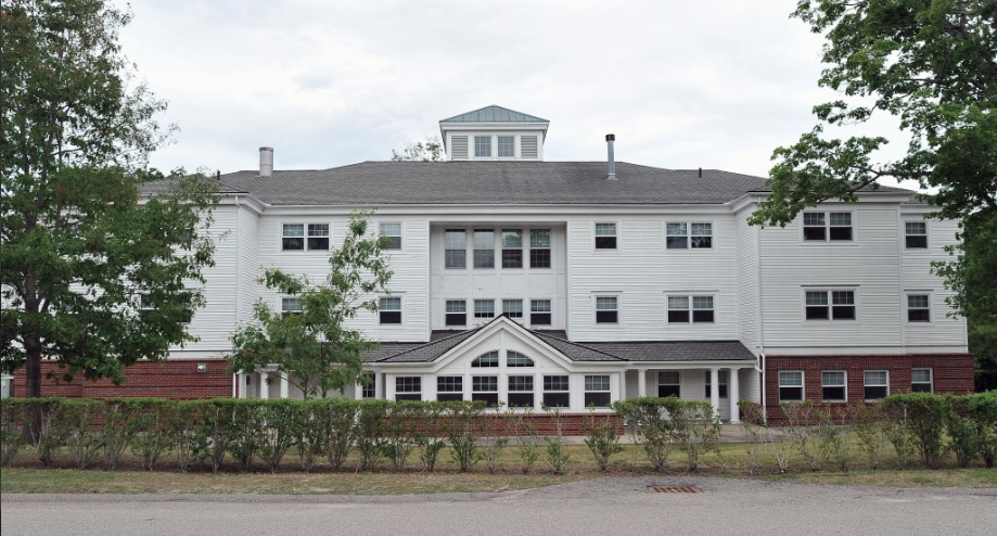 Here is a photo of a white building with numerous windows on it.