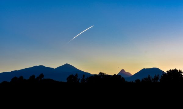A photo of a shooting star over the mountain range in Rwanda