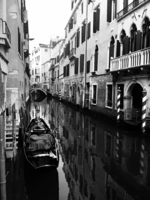 A black and white photo of Venice and its water slowly rising over the years.
