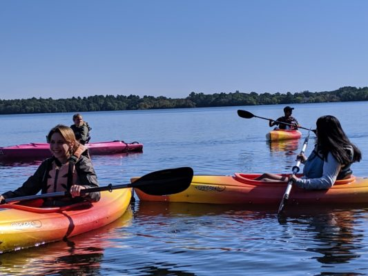 A group of students in the water kayaking