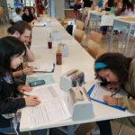 A group of students completing paperwork during the resource fair