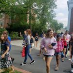 A group of new students walking around campus