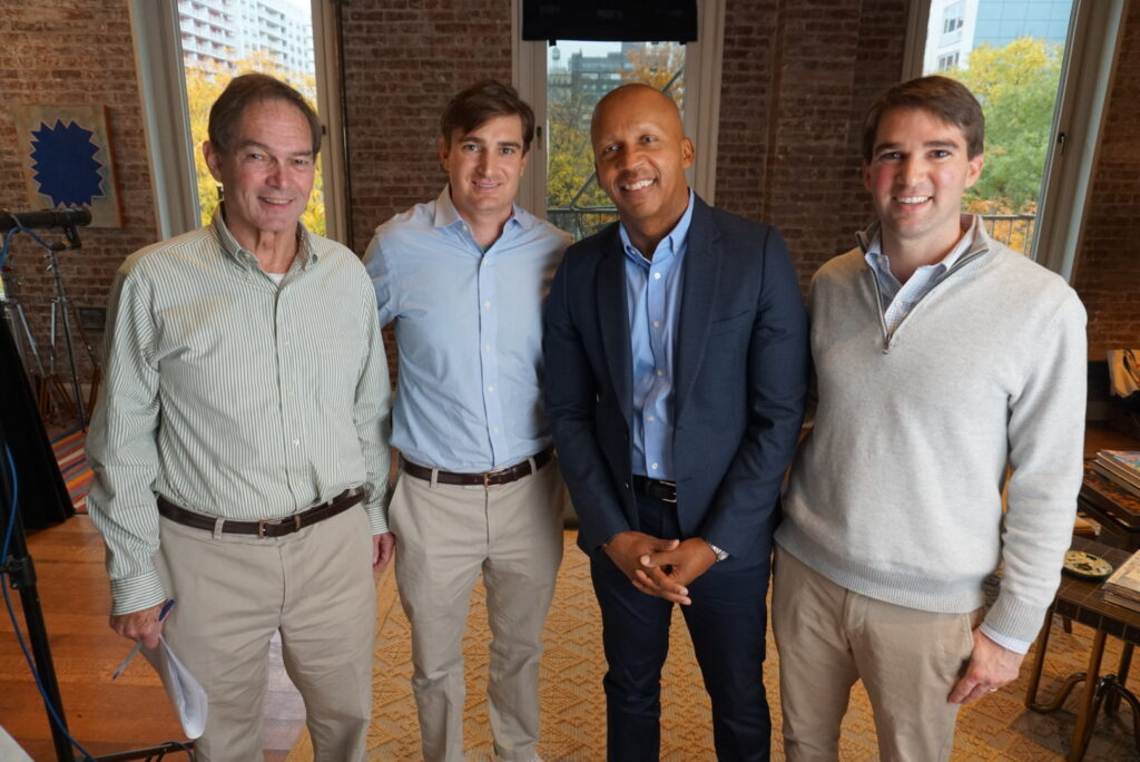 Photo of George Kundhart, Class of 2009, with father, brother and Bryan Bryan Stevenson