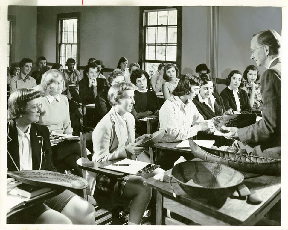 Archival photos of students in a classroom