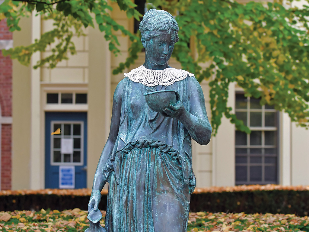"""Photo of the statue of Hebe adorned with a distinctive """"RBG"""" collar"""